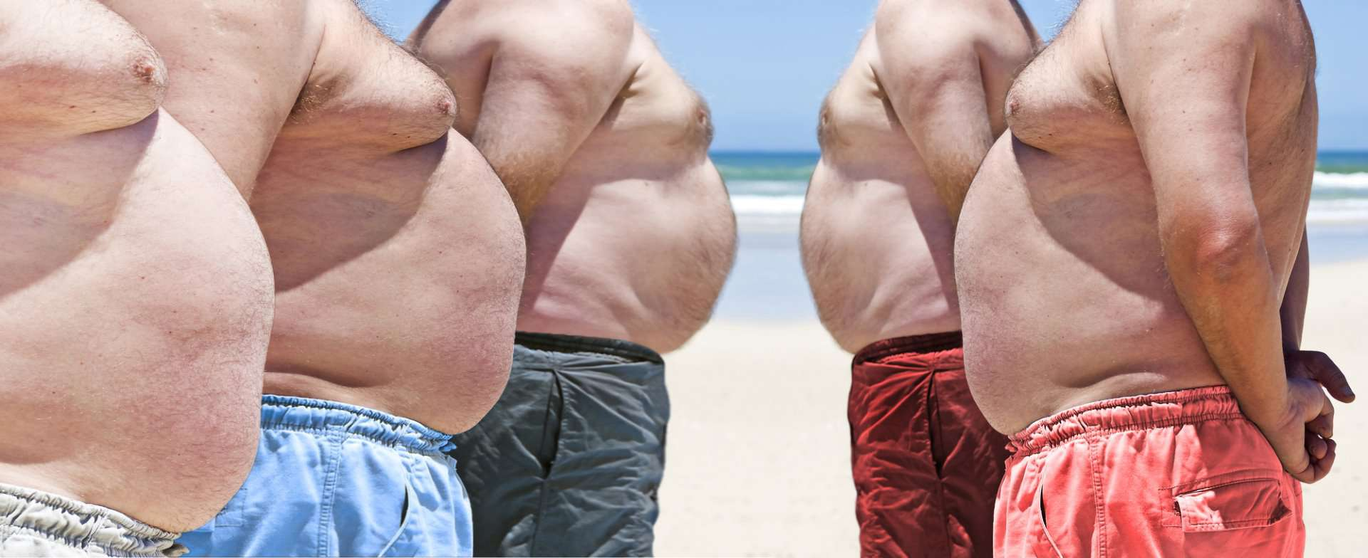 Obese men on the beach